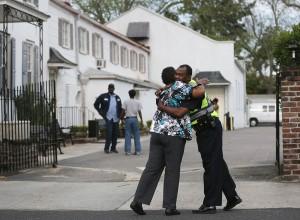 Walter Scott funeral black woman hugs black policeman